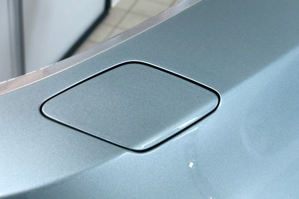 BMW M3 front bumper close up of washer jet cover